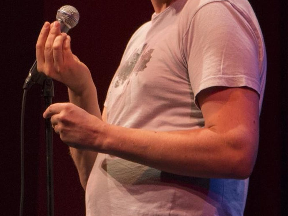 Comedian Pete Holmes pretends to eat Fun Dip candy during the Limestone Comedy Festival on Saturday at the Buskirk-Chumley Theater.