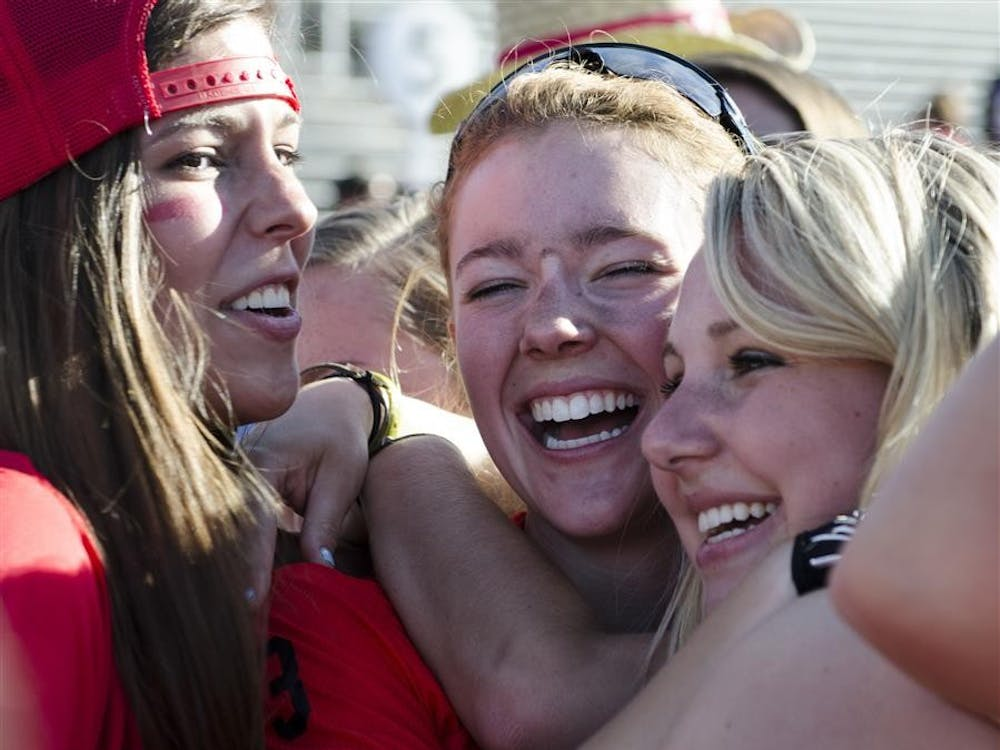 Abby Rogers of Kappa Alpha Theta is surrounded by friends and supporters after her team took first place in the Little 500 women's race Friday at Bill Armstrong Stadium. Kappa Alpha Theta won with a time of 1:13:11.425.