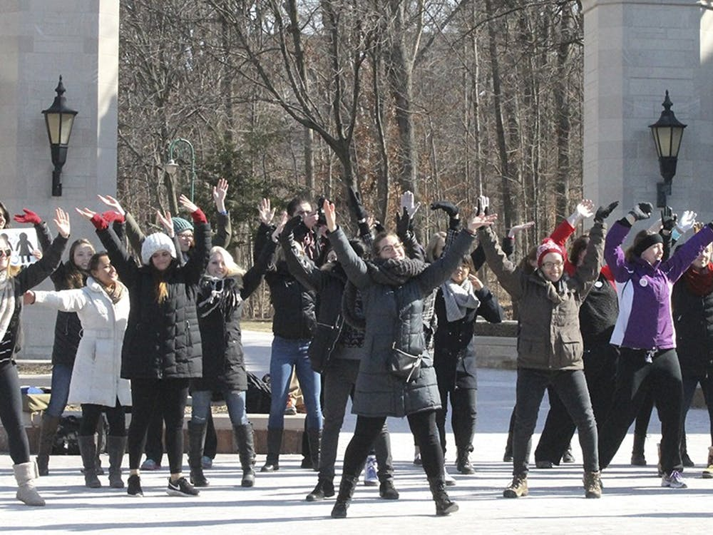 Students take part in a flash mob at in front of spectators on Indiana Avenue and Kirkwood to raise awareness of domestic abuse and sexual violence.