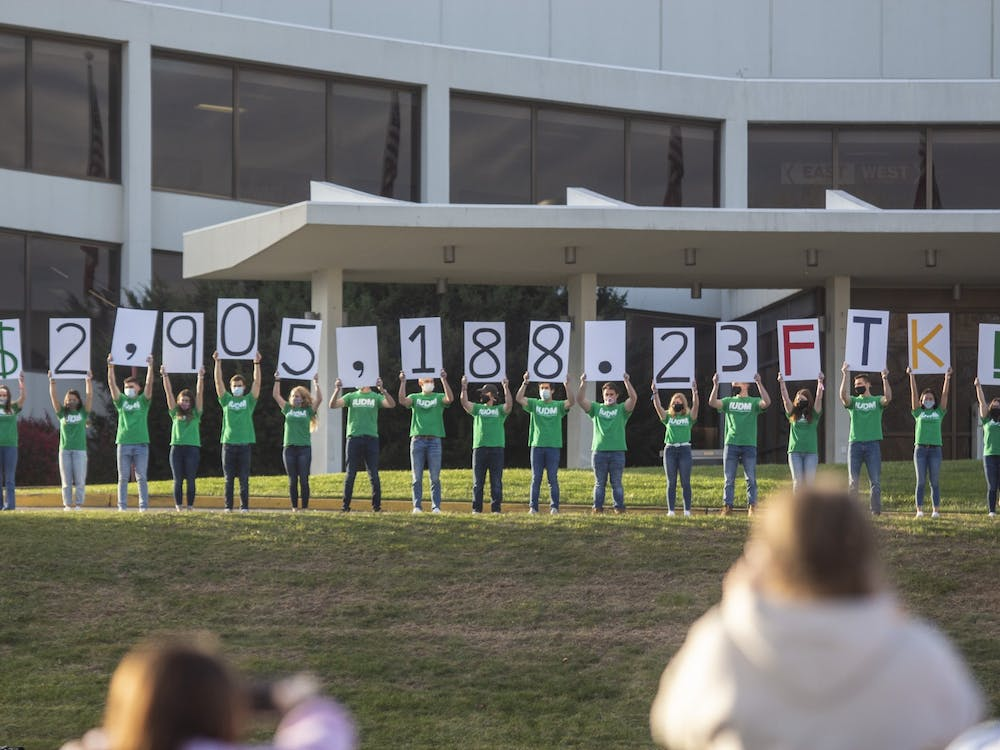 IU Dance Marathon members hold up signs displaying the final total of $2,905,188.23 on Nov. 8 in front of Simon Skjodt Assembly Hall. The dance marathon, which raises money every year for Riley Hospital for Children, took place in a hybrid format this year, with virtual components and in-person components at Dunn Meadow and outside Assembly Hall.