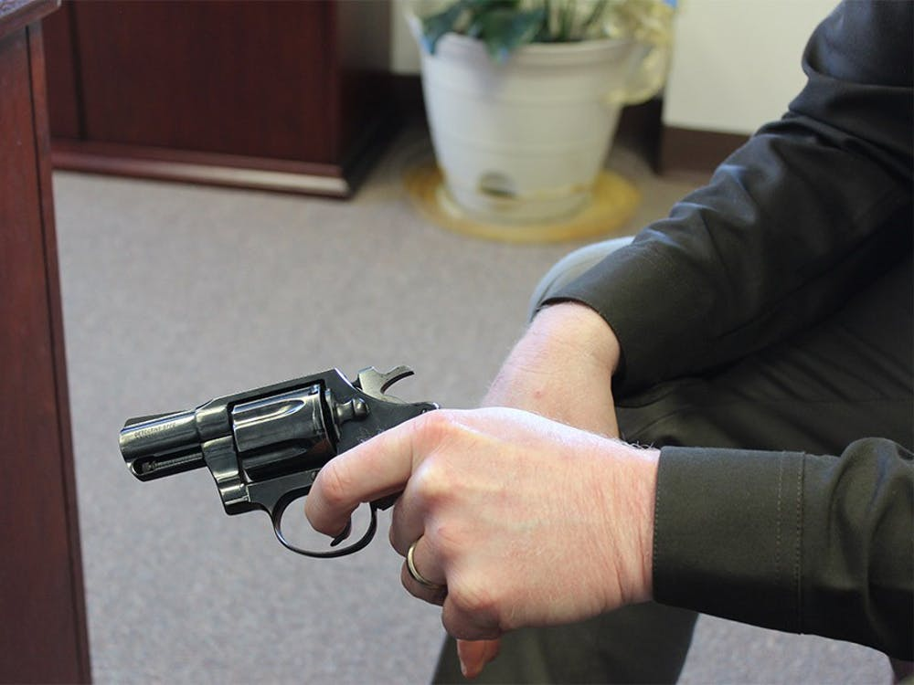 Sheriff Matt Myers holds a .38 caliber pistol, the same type of weapon used by a 6-year-boy who accidently shot his father Sunday in Barthlomew county.
