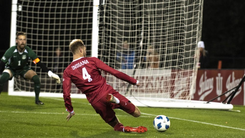 Redshirt junior A.J. Palazzolo attempts to save a ball from going out of bounds against the University of Evansville on Oct. 22 at Bill Armstrong Stadium. Their win over Evansville meant an improvement to 9-2-3 on the season.