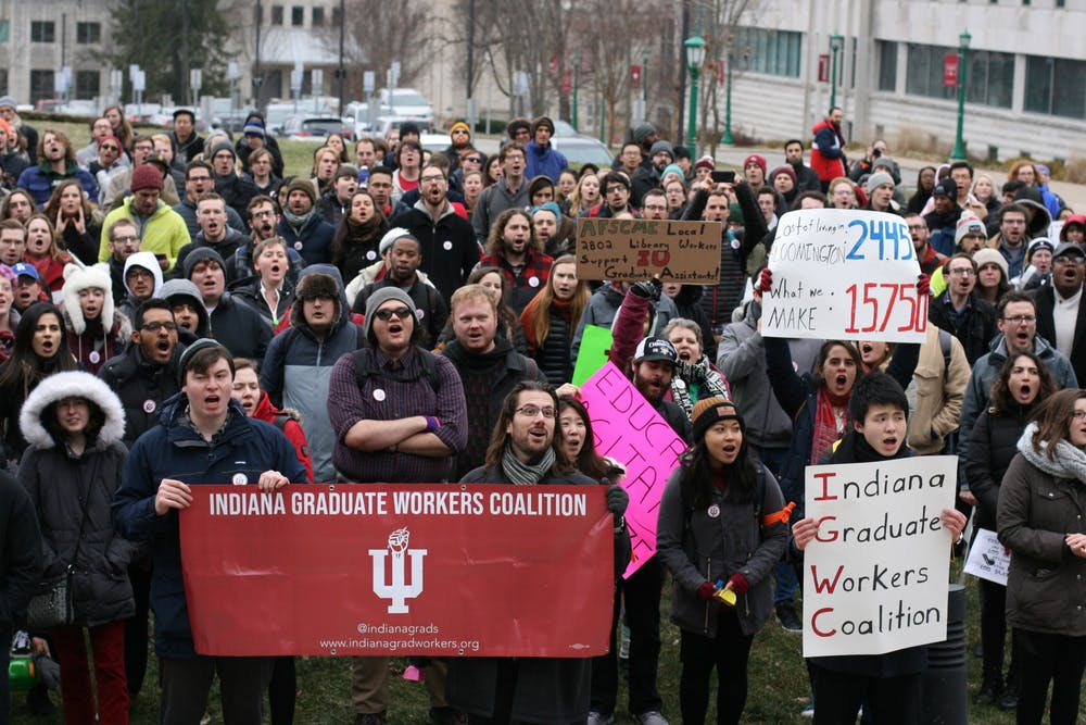 <p>IU graduate students and supporters march in a protest against mandatory fees Jan. 28, 2020. Members of the Graduate Workers Coalition plan to picket in front of Bryan Hall on Thursday in support of the ongoing fee strike. </p>