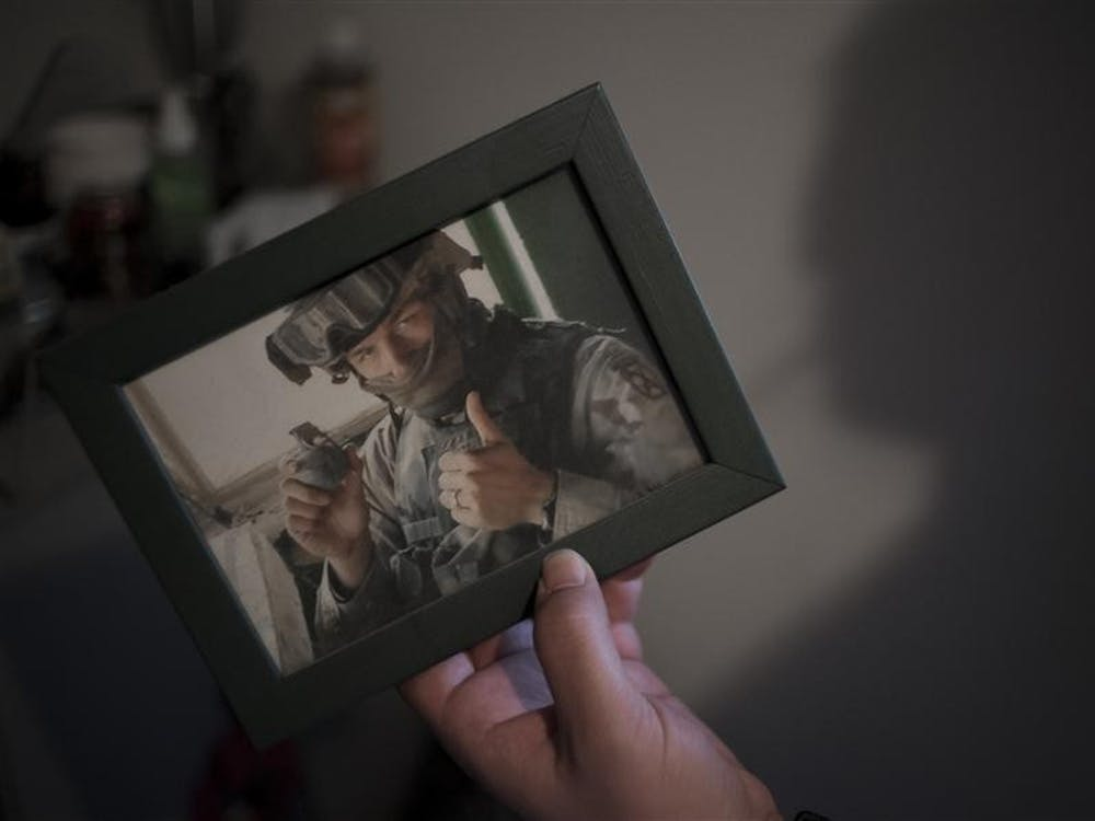 """""""Ever seen somebody holding a live frag grenade?"""" Sgt. McCool asked. """"Here you go. That's Iraq."""" In his nine years, five months and five days enlisted in the Army, Sgt. McCool deployed to Kosovo once and to Iraq twice - first during the Battle of Fallujah and next to Baghdad. Now a student at Indiana University, McCool has assumed the role of head coach for the Indiana Cutters semi-pro football team, furthering his love for a sport he enjoyed playing before the war."""