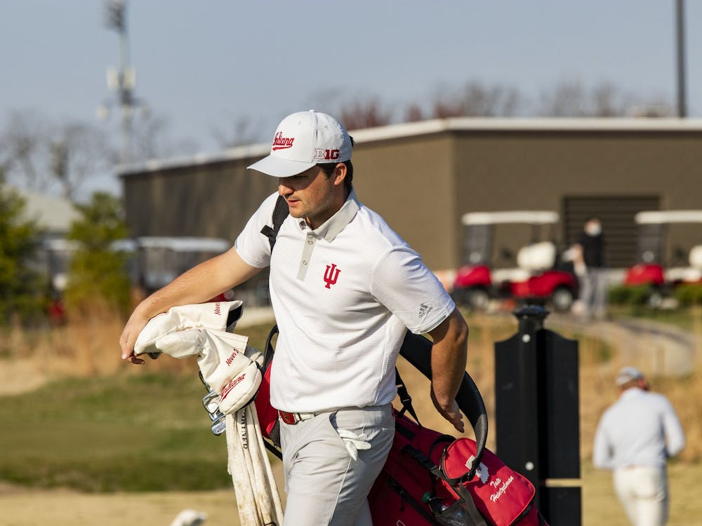 Senior Tate Heintzelman puts on his bag during the Hoosier Collegiate Invitational on April 4 at the Pfau Course. The IU men's golf team will be competing at the Robert Kepler Intercollegiate on Saturday and Sunday in Columbus, Ohio.