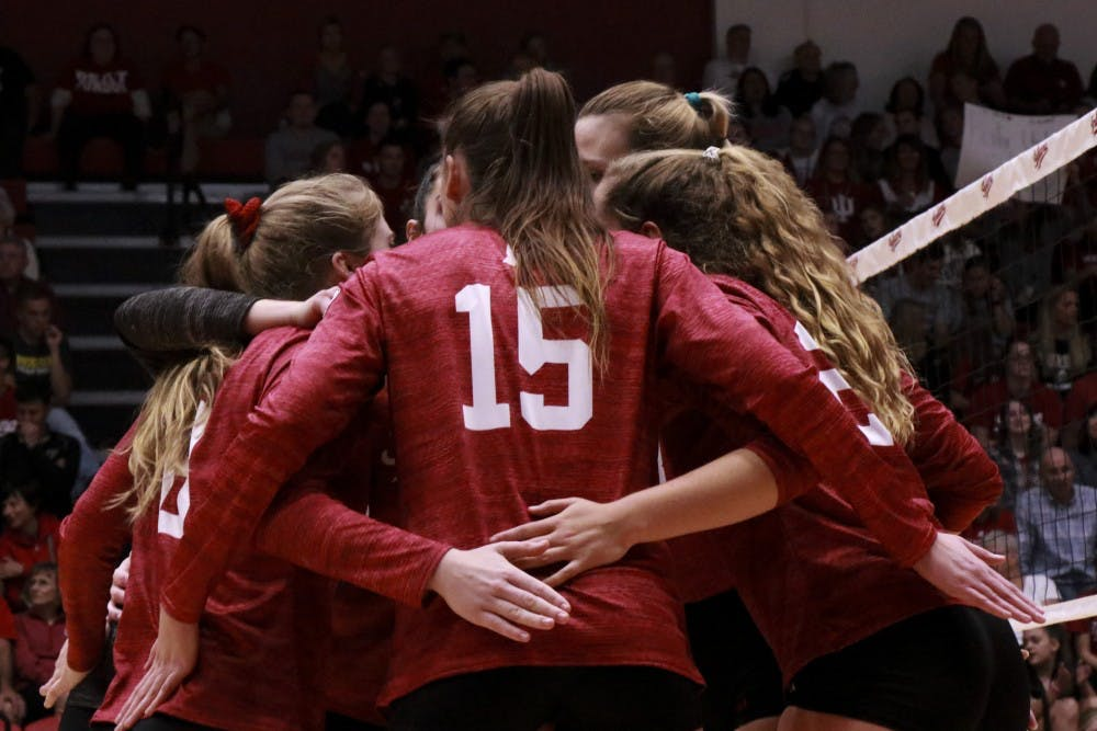 <p>Players meet during an intense part of the game against Purdue on Oct. 9 at Wilkinson Hall. IU lost to Maryland in five sets Wednesday night.</p>
