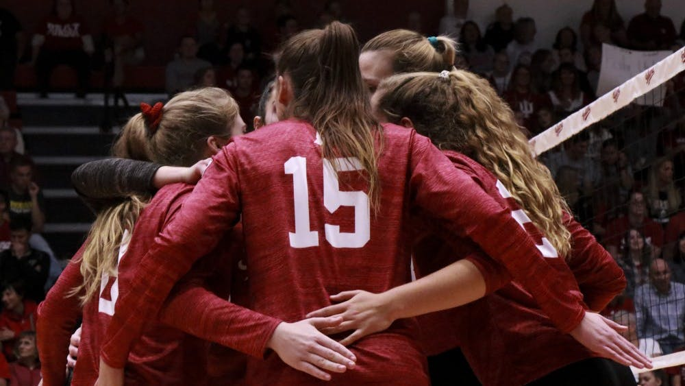 Players meet during an intense part of the game against Purdue on Oct. 9 at Wilkinson Hall. IU lost to Maryland in five sets Wednesday night.