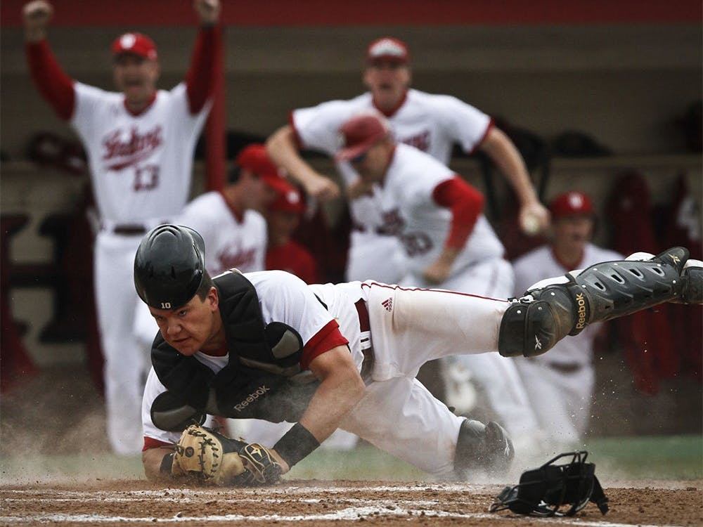 Freshman catcher Kyle Schwarber dives after tagging out a Michigan State player during IU's 3-2 win April 13 at Sembower Field.