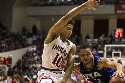 Freshman guard Rob Phinisee blocks a University of Texas at Arlington player from scoring Nov. 20 in Simon Skjodt Assembly Hall. The Hoosiers won the game 78-64.