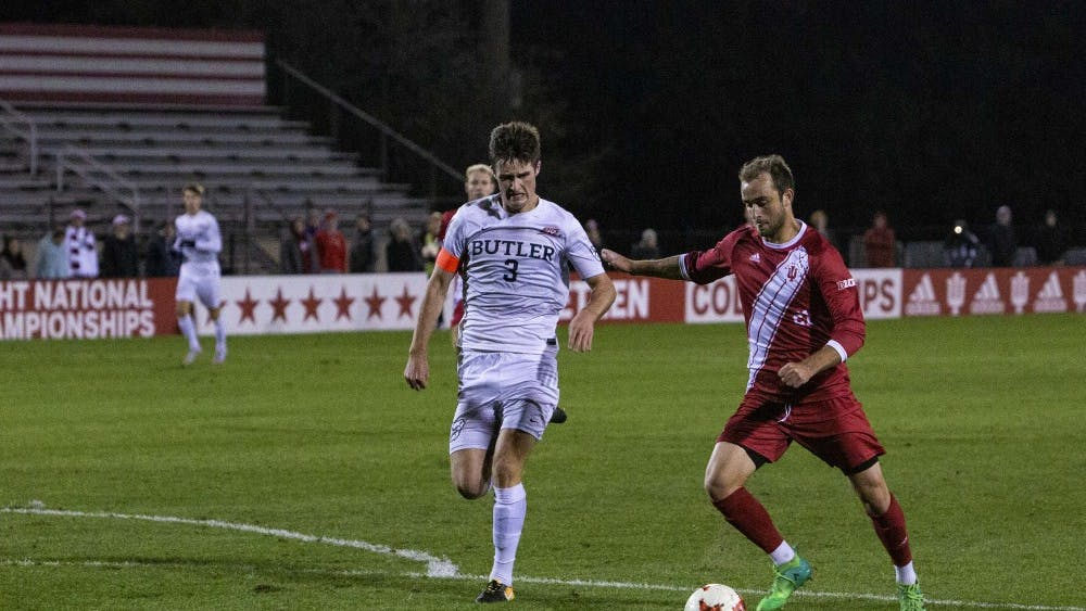 Sophomore midfielder Spencer Glass goes to kick the ball toward Butler's goal during IU's game Oct. 16 at Bill Armstrong Stadium. Glass's kick resulted in a goal to finish the game. IU defeated Butler, 3-0.