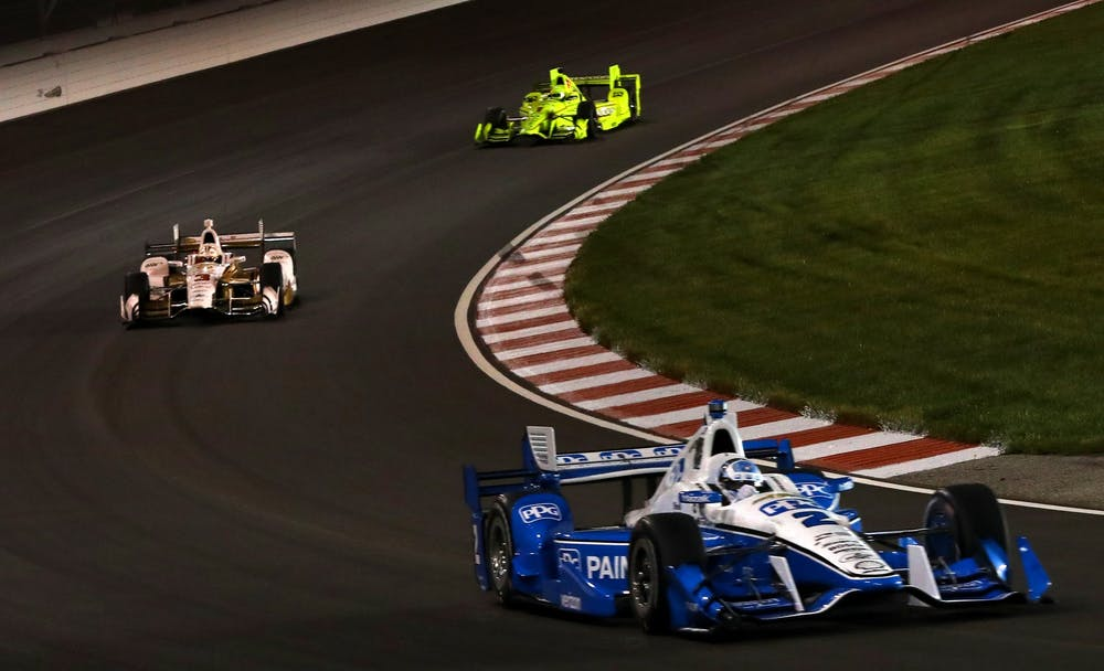 <p>Josef Newgarden, right, of Team Penske is followed by team members Helio Castroneves, left, and Simon Pagenaud in the Bommarito Automotive Group 500 IndyCar race on Saturday, Aug. 26, 2017, at Gateway Motorsports. Castroneves won the 2021 Indy 500.</p>