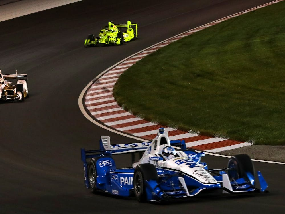 Josef Newgarden, right, of Team Penske is followed by team members Helio Castroneves, left, and Simon Pagenaud in the Bommarito Automotive Group 500 IndyCar race on Saturday, Aug. 26, 2017, at Gateway Motorsports. Castroneves won the 2021 Indy 500.
