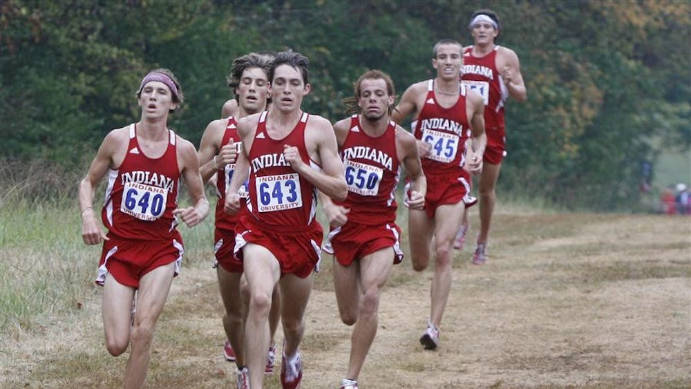 A pack of Hoosier runners, led by redshirt freshman Andrew Bayer, sprint toward the finish line at the Indiana Open on Sept. 11 at the IU cross country course.