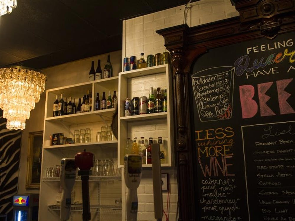 A beer and wine list adds to the eclectic feel at The Back Door, a queer bar that opened Feb. 13. The Back Door is located behind The Atlas Bar downtown.