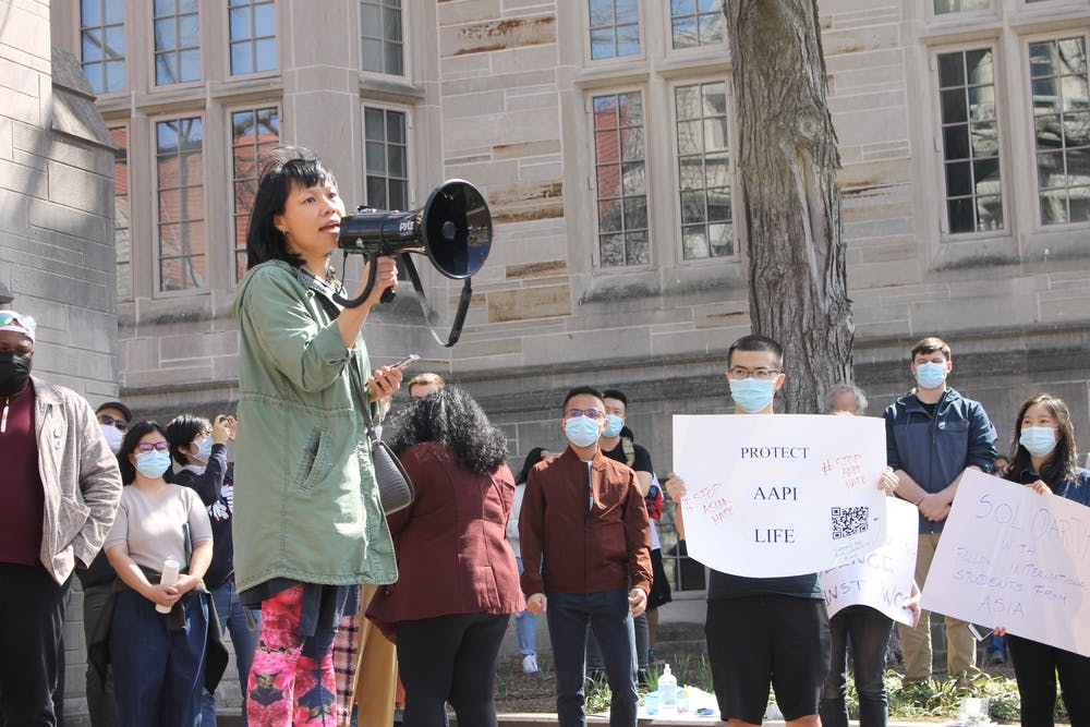 <p>Ellen Wu, a professor of history and Asian American studies at IU and a representative from the National Asian Pacific American Women's Forum Indiana Chapter, addresses the crowd Wednesday at the Sample Gates during the Gathering Against Asian Hate. Organizers held a moment silence in remembrance of the Atlanta shooting victims.</p>