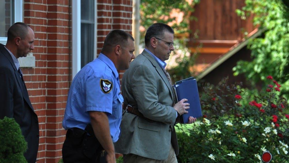 Daniel Messel is led out of the Brown County Courthouse and to a waiting car in Nashville, IN on Friday.