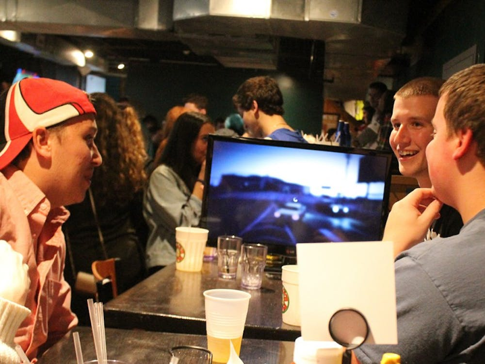 Skylar Booth,  Dylan Karnedy and Chris Neal, all members of Phi Kappa Tau, play video games that they brought to Kilroys on Kirkwood Monday afternoon. Many students bring games and other things to keep themselves entertained while participating in KOK's open to close.