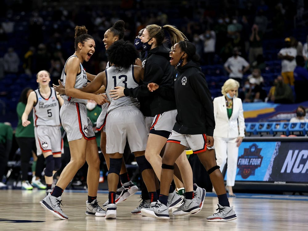 The University of Connecticut women's basketball team celebrates  Monday after beating Baylor in San Antonio, Texas. The Huskies will advance to the Final Four and face the University of Arizona on Friday.