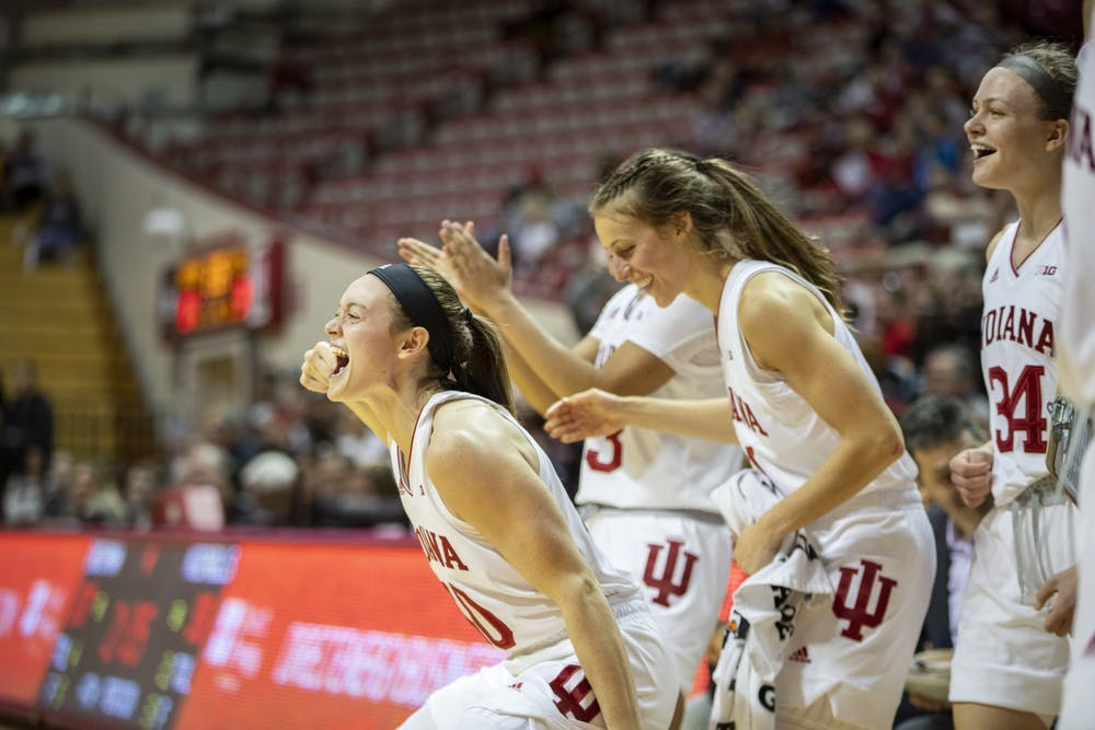<p>Senior Brenna Wise cheers on freshman Grace Waggoner after being fouled Nov. 10 at Simon Skjodt Assembly Hall. No. 17 IU beat the No. 5 University of South Carolina in in a 71-57 upset in the first round of the Paradise Jam tournament in the U.S. Virgin Islands.</p>