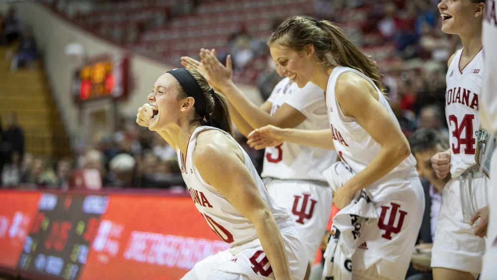 Senior Brenna Wise cheers on freshman Grace Waggoner after being fouled Nov. 10 at Simon Skjodt Assembly Hall. No. 17 IU beat the No. 5 University of South Carolina in in a 71-57 upset in the first round of the Paradise Jam tournament in the U.S. Virgin Islands.