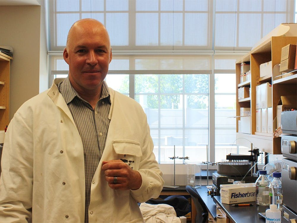 Stephen Bell, professor of biology, stands in his lab where he researches cell division in Simon Hall on Tuesday. Bell was recently named a fellow to the American Academy of Microbiology.