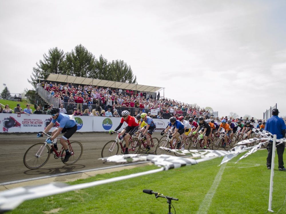 Riders race along the fourth turn during the men's Little 500 race Saturday in Bill Armstrong Stadium.