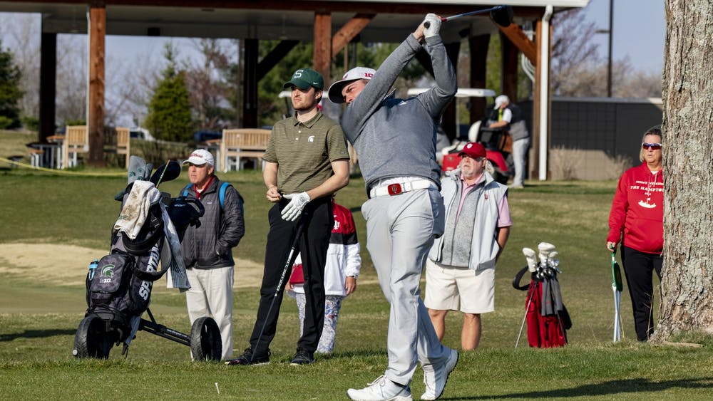 Graduate student Brock Ochsenreiter follows through with his swing after hitting the ball during the Hoosier Collegiate Invitational on April 4 at the Pfau Course. Ochsenreiter was awarded the Big Ten men's co-Golfer of the Week on Wednesday.