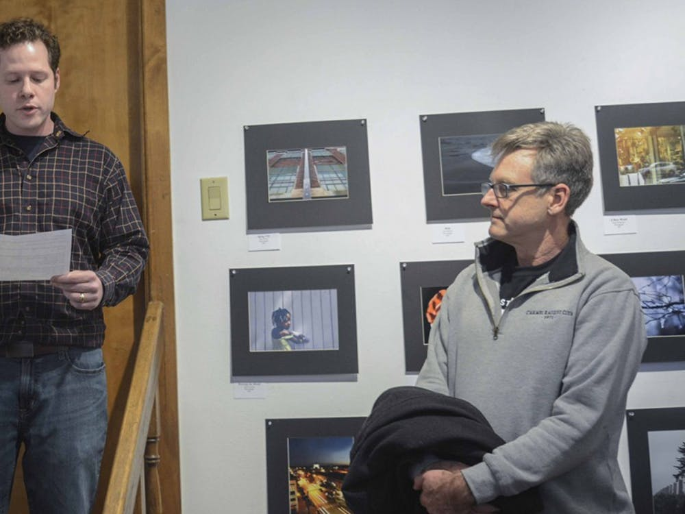 Gabriel Colman (left), the owner and curator of The Venue, Fine Art & Gifts, are announcing the award winners during the Juried Arts student show at The Venue, Jan 29.