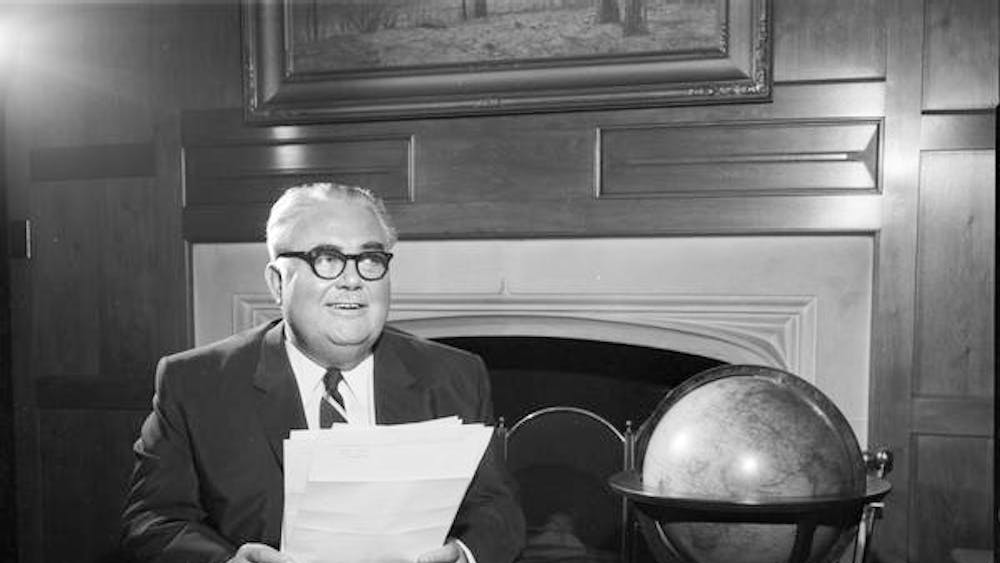 Herman B Wells at his desk in 1959. Wells served in many roles at IU including president from 1937-1962.