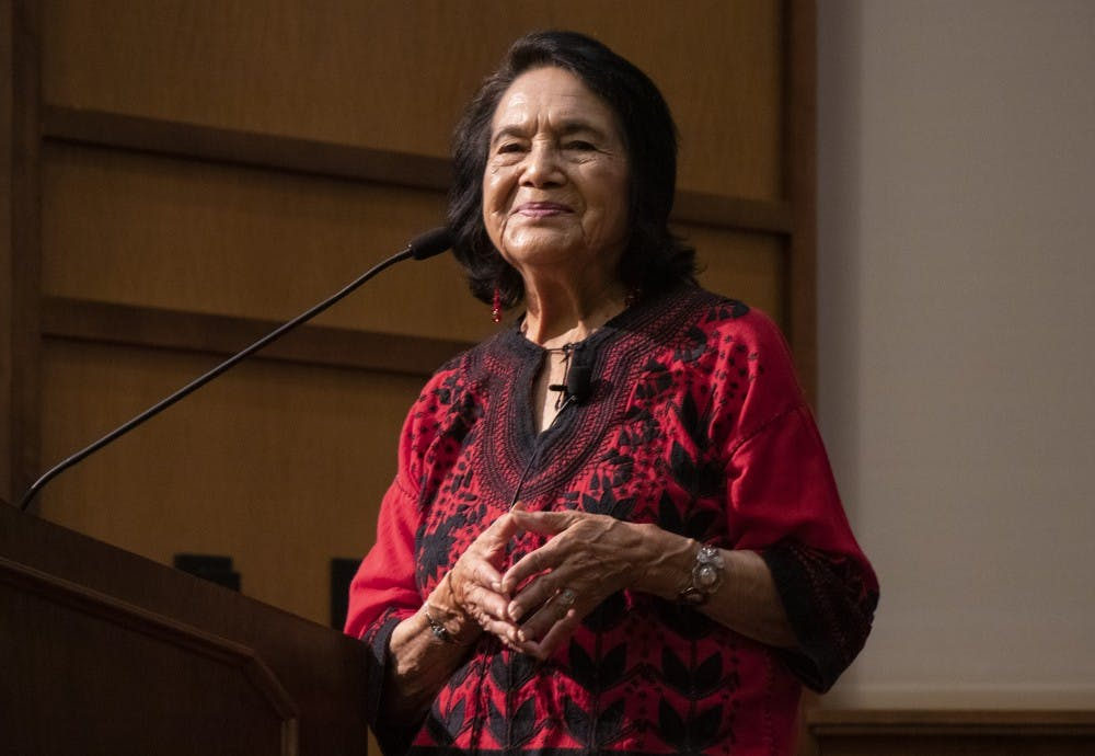 <p>Civil rights activist Dolores Huerta smiles as the audience applauds during her address Sept. 19, 2019, at Franklin Hall. Huerta is an active American labor leader known for her work with civil rights activist Cesar Chavez.</p>