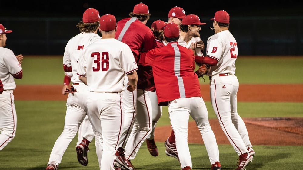 <p>The IU baseball team celebrates after their 8-0 victory against Illinois on April 10 in Bloomington. The Hoosiers will compete against Northwestern this weekend in Evanston, Illinois. </p>