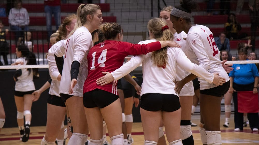 IU volleyball players confer between points during the fifth set against Iowa Oct. 26 at Wilkinson Hall. IU lost in a match to the Cornhuskers, 2-3.