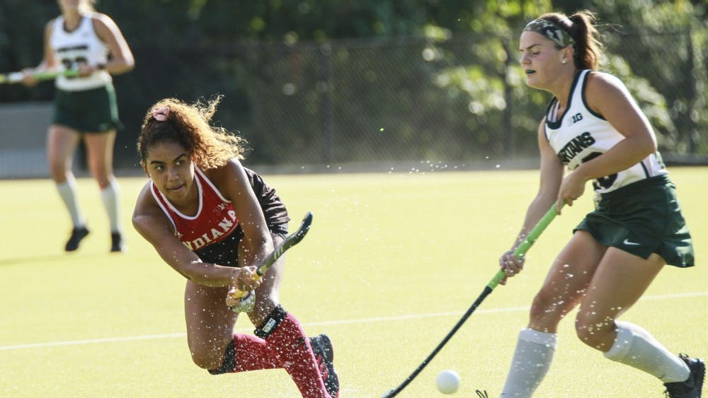 Now-senior midfielder Andi Jackson hits the ball past a Michigan State player Oct. 6 at the IU Field Hockey Complex. The Hoosiers lost against Miami University on Friday, 5-2.