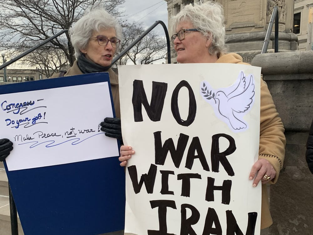 Lynne Shifress, right, protests Jan. 9 in front of the Monroe County Courthouse. Shifress organized the protest as part of a large movement sponsored by public policy advocacy group MoveOn, which called for anti-war protests against the recent escalations in Iraq against Iranian militants.