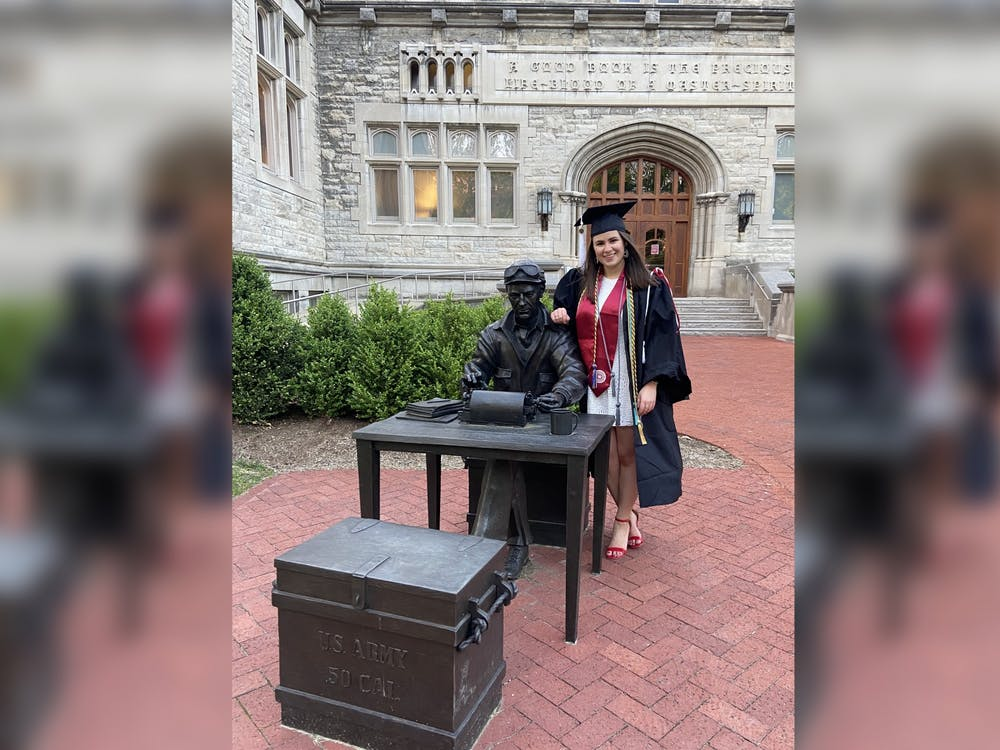Editor-in-chief Lydia Gerike poses for a photo May 7 next to the Ernie Pyle statue outside Franklin Hall.