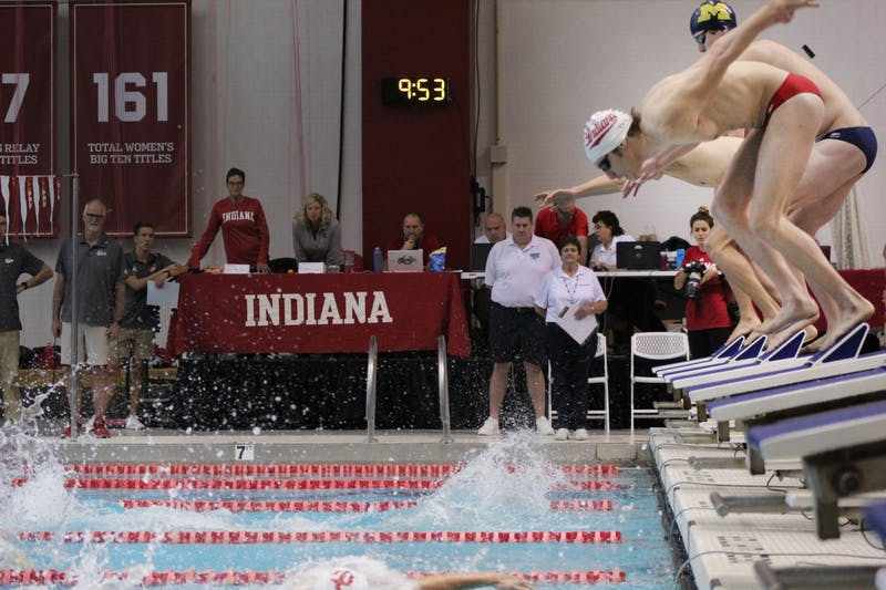 Swimmers in the men's 400 free relay kick off their starting blocks Nov. 2 at the Counsilman-Billingsley Aquatics Center. The meet ended with IU beating Iowa 245-55 and IU beating Michigan 165-135.