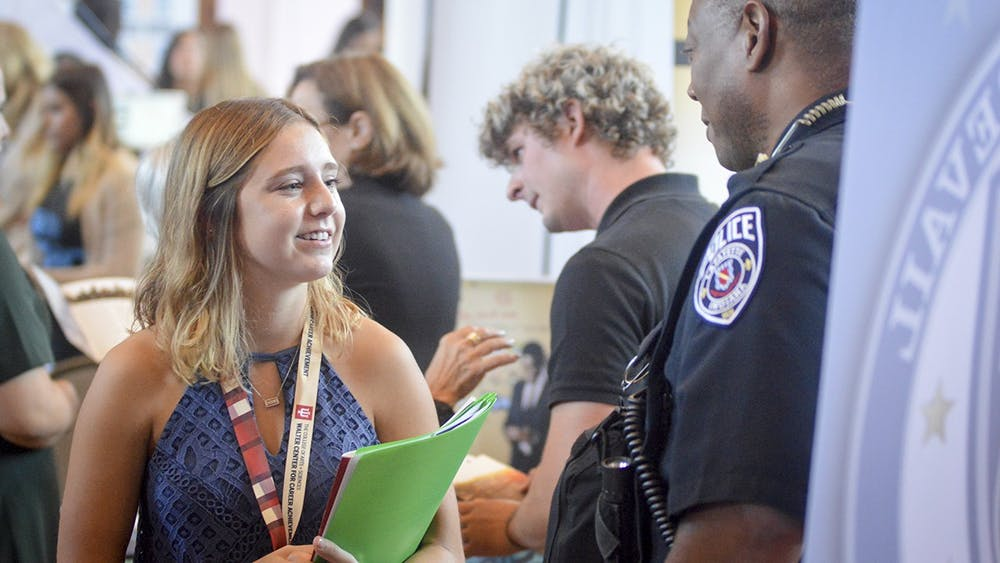 Then-sophomore Elizabeth Nykaza speaks to the Lafayette County Police Department on Sept. 13, 2016, at the College of Arts and Sciences Career Fair in Alumni Hall.
