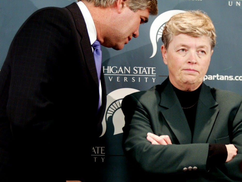 Michigan State University Trustee David L. Porteous, left, speaks with MSU President Lou Anna K. Simon. Simon resigned her position as President Wednesday after Larry Nassar's sentencing.