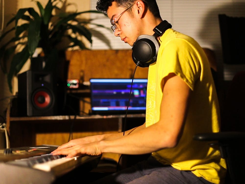 IU junior Matthiue Picard sits and plays piano while recording music. Picard is the founder of the Bloomington-based band SD Gloria.