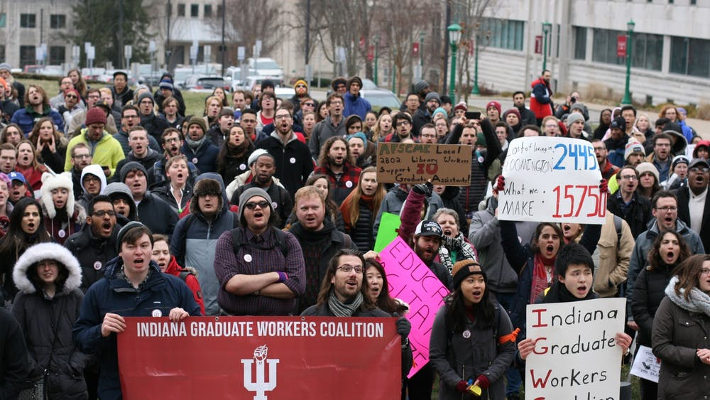 IU graduate students and supporters march in a protest against mandatory fees Jan. 28, 2020. The IU School of Education announced it will waive unremittable fees, which usually total about $1000 per year for graduate students, starting in Fall of 2021.