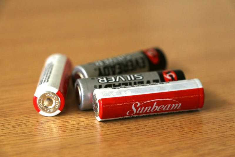Dead batteries lay on a table Jan. 22 in Willkie Quad. Batteries can be recycled at Monroe County Solid Waste Management on South Walnut Street.