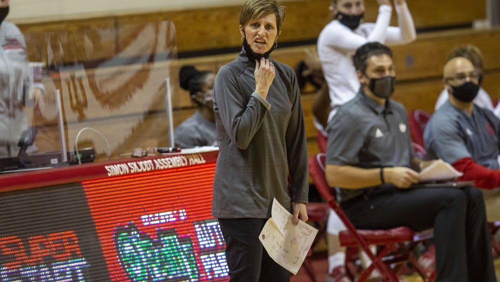IU women's basketball head coach Teri Moren pulls down her mask to shout instructions in the game against the University of Tennessee on Dec. 17, 2020, in Simon Skjodt Assembly Hall. No. 11 IU took down Wisconsin 77-49 on the road Wednesday.