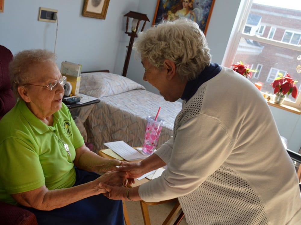 Sisters Irene Hoff and Alacoque Burger catch one another up on the day's happenings in Irene's room.Irene will celebrate her 70th Jubilee this April, which meansshe has been a sister of St. Francis for 70 years.