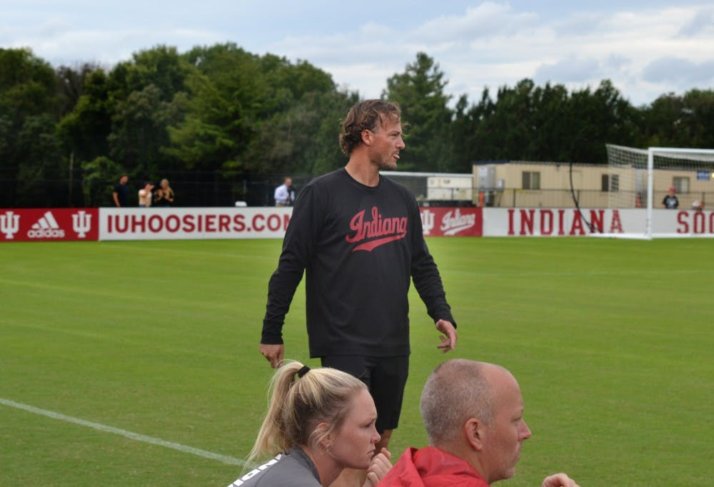 <p>IU women&#x27;s soccer head coach Erwin Van Bennekom looks at the team Sept. 8 in a game against Morehead State University at Bill Armstrong Stadium. The Hoosiers won 5-0.</p>