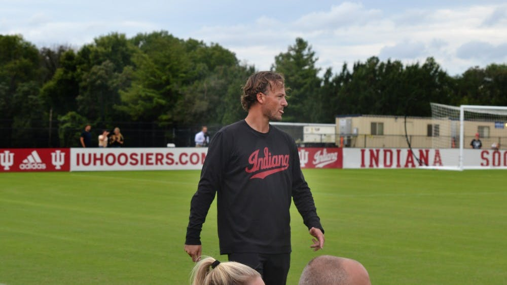 IU women's soccer head coach Erwin Van Bennekom looks at the team Sept. 8 in a game against Morehead State University at Bill Armstrong Stadium. The Hoosiers won 5-0.