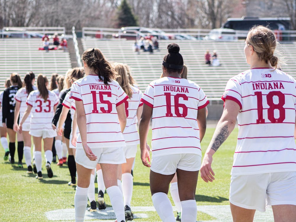 The IU women's soccer team walks onto the field March 21 at Bill Armstrong Stadium. IU lost 3-1 Sunday to Penn State.