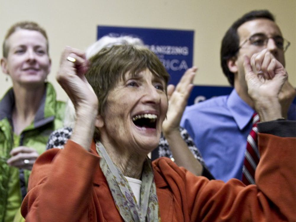 Bloomington resident Nita Levison cheers for Mayoral Primary candidate Mark Kruzan as new results are posted on the white board for the Mayoral Primary Election on May 17, 2011 at the Monroe County Democratic Party Headquarters. Kruzan beat John Hamilton in the Democratic Mayoral Primary.