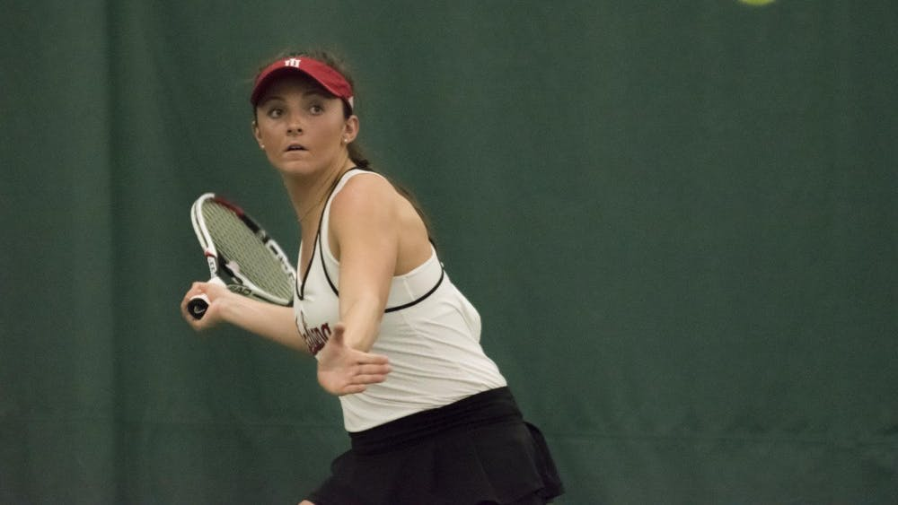 Freshman Michelle McKamey eyes a forehand during her 6-4, 6-4 singles win over DePaul. After defeating the Blue Demons 4-0, the Hoosiers improved to 15-8 on the season.
