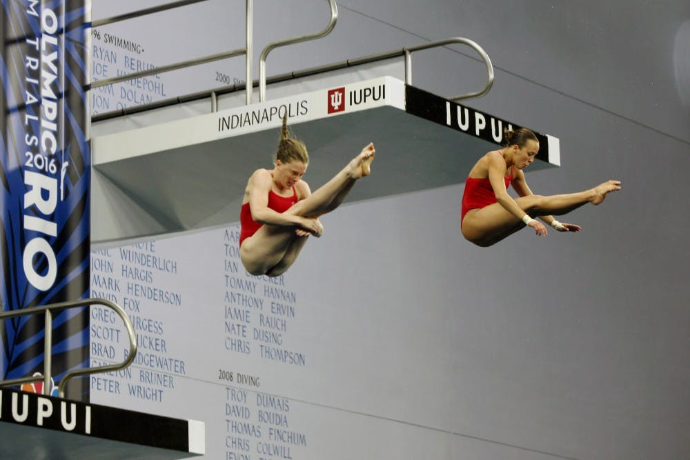 Amy Cozad, left, and Jessica Parratto, right, release out of pike position during the women's synchronized 10-meter preliminaries at the 2016 U.S. Olympic Team Trials in Indianapolis Saturday.
