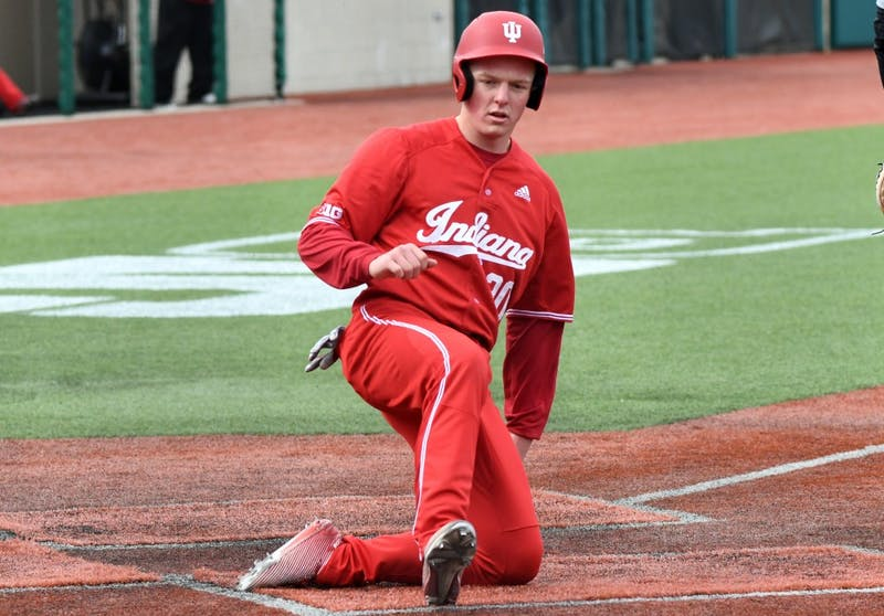 Then-sophomore infielder Scotty Bradley, now a junior, slides into home plate against Purdue on April 8, 2018, at Bart Kaufman Field.
